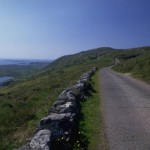 Boundary wall, ocean and road