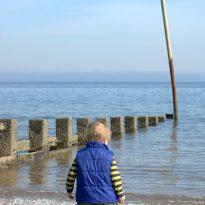 Child stuck sand